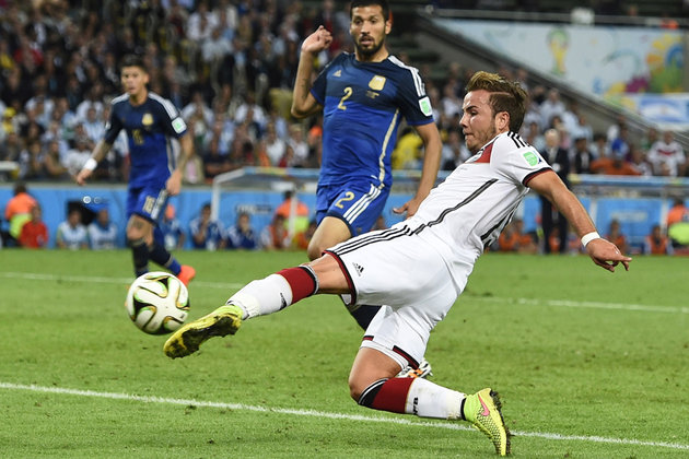 Germany's Goetze shoots to score a goal against Argentina during extra time in their 2014 World Cup final at the Maracana stadium in Rio de Janeiro